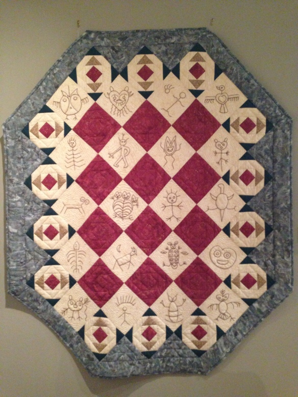 Petrogylphs, by Cathy Favret, 2001. Donated by Cathy Favret. Courtesy the Latimer Quilt and Textile Center.