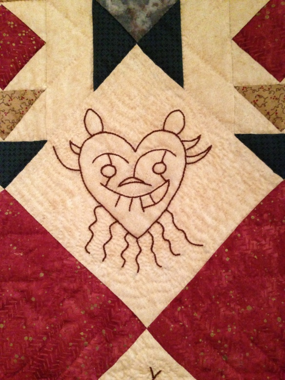 Detail, Petroglyphs, by Cathy Favret, 2001. Donated by Cathy Favret. Courtest the Latimer Quilt & Textile Center.